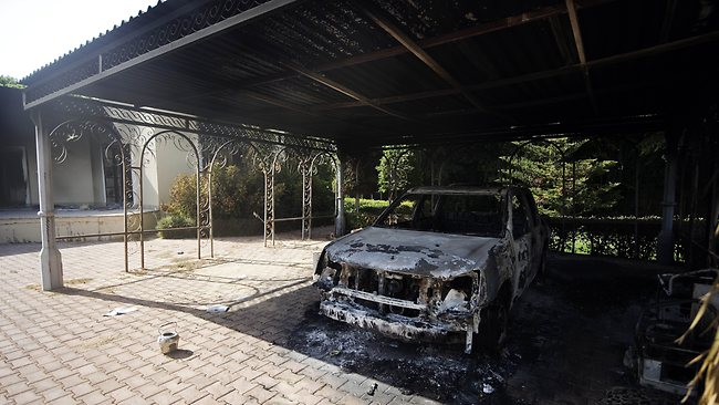 A burnt vehicle inside the US consulate compound in Benghazi. Picture: AFP