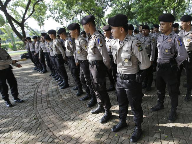 Police Officers ... The Indonesian government deployed tens of thousands of security personnel to safeguard the year-end holidays. Picture: AP