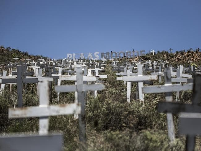 Crosses are planted on a hillside at the White Cross Monument, each one marking a white farmer who has been killed on farms. Picture: Gulshan Khan/AFP