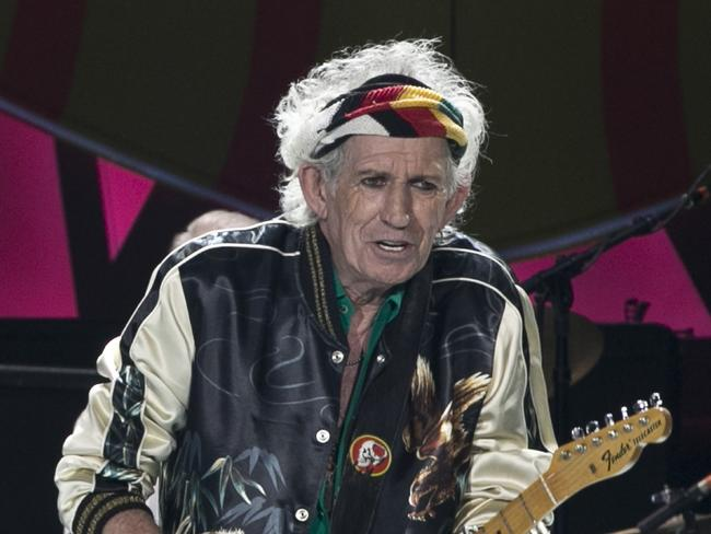 Defiant ... Keith Richards plays his guitar as the Rolling Stones perform in Havana, Cuba. Picture: AP