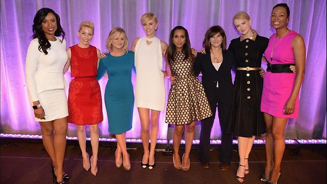 Left to right: honorees Jennifer Hudson, Elizabeth Banks, Amy Poehler, Charlize Theron, Kerry Washington, Amy Pascal, Nicole Kidman and host Aisha Tyler pose onstage at Variety's 5th annual Power of Women event. Sources say Theron wore the scarf to hide evidence of an apparent a neck surgery.