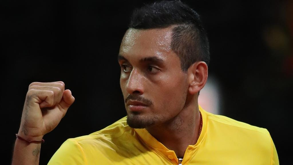 Nick Kyrgios has saved Australian on day one in the Davis Cup tie against Belgium.