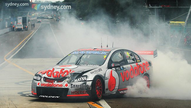 Sydney 500 V8 Supercars at Homebush, Sydney. Jamie Whincup celebrates with a burnout after taking out the 2012 championship. Picture: Brett Costello