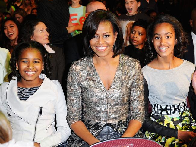 Sasha Obama, former First Lady Michelle Obama and Malia Obama at the Nickelodeon's Kids' Choice Awards in 2012. Picture: Kevork Djansezian/Getty Images