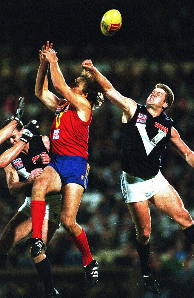 Glen Archer (rear) spoils Tony Modra mark during South Australia v Victoria AFL State of Origin game at Football Park in 1997.