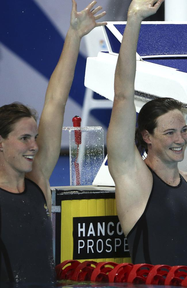 Cate Campbell (right) and sister Bronte celebrate after the women's 100m final. Cate won and Bronte came second.