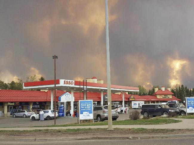 Smoke rises from a wildfire outside of Fort McMurray, Alberta. Picture: Mary Anne Sexsmith-Segato/The Canadian Press via AP