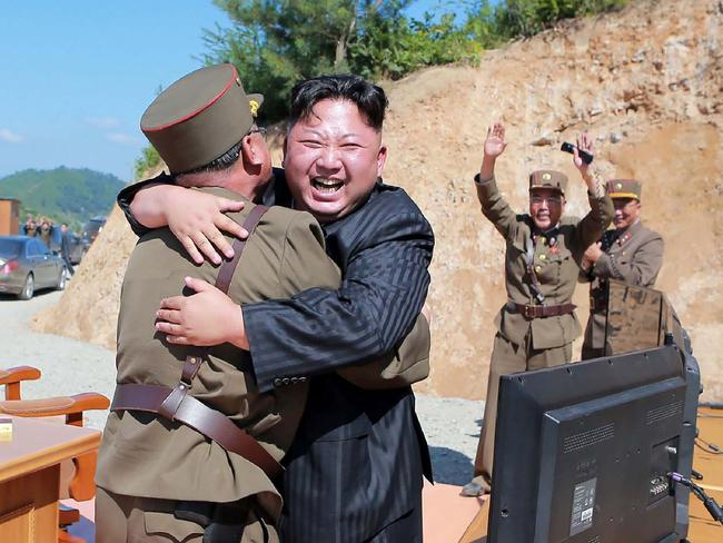 Kim Jong-un celebrates the successful test-fire of the intercontinental ballistic missile. Picture: AFP/KCNA via KNS/STR