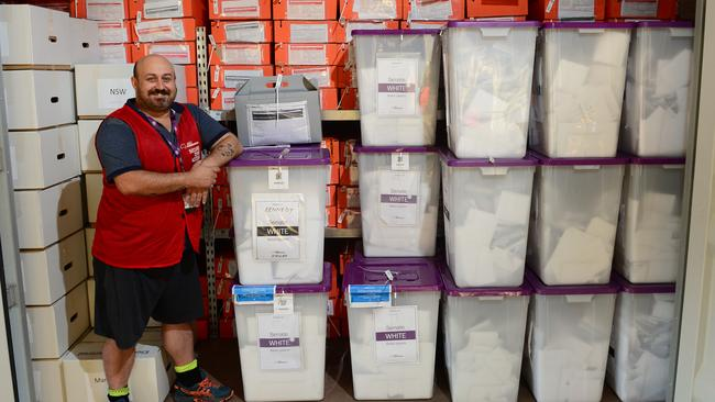 Divisional Materials Manager for Herbert Jason Blake inside one of the two shipping containers full of Senate Ballots, Pre-polling votes, and Out of State Declarations to be posted in Townsville. Picture: Wesley Monts