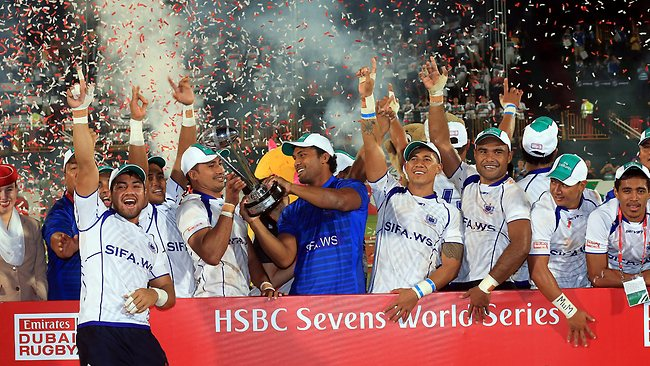 The victorious Samoan team celebrate with the trophy after their win over New Zealand in the final of the Dubai Rugby Sevens.
