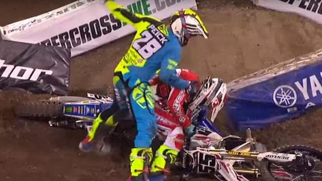 Weston Peick punches Vince Friese during Anaheim AMA Supercross.