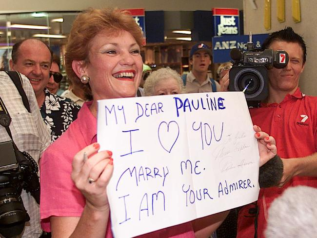 Pauline Hanson at Australia Fair Shopping Centre holding a supporters placard in 2001.