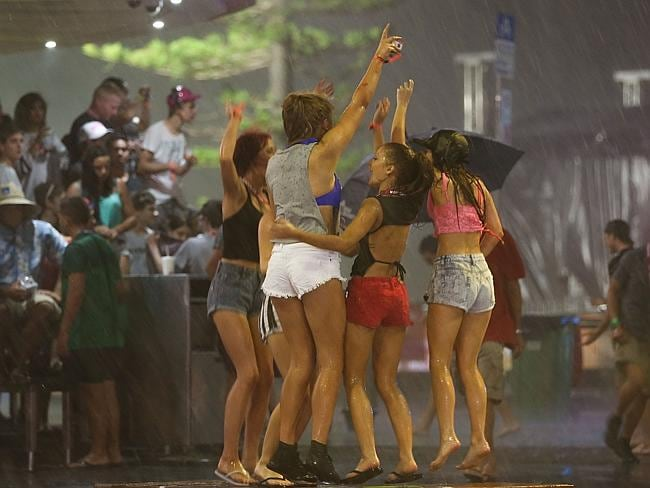 School leavers dance in the rain in Surfers Paradise. Pic: Lindsay Moller.