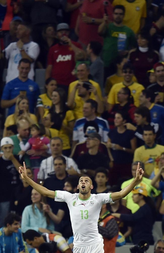 Algeria's Islam Slimani celebrates after scoring the equaliser against Russia.