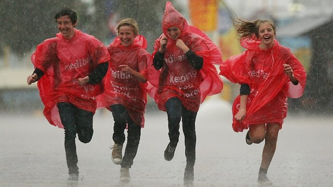 Patrons leave as the wet weather sets in at the Royal Melbourne Show. Picture: Darren McNamara
