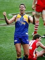 2006 Grand Final. Sydney Swans v West Coast Eagles. MCG. Dean Cox celebrates the siren sounding as Brett Kirk sits on the ground.