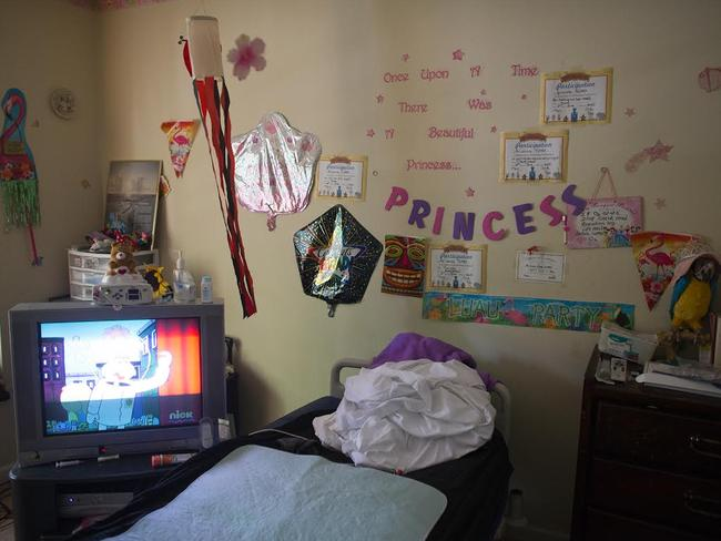 Stark contrast... the little girl's room in the same house. Pic: Sean Simmers