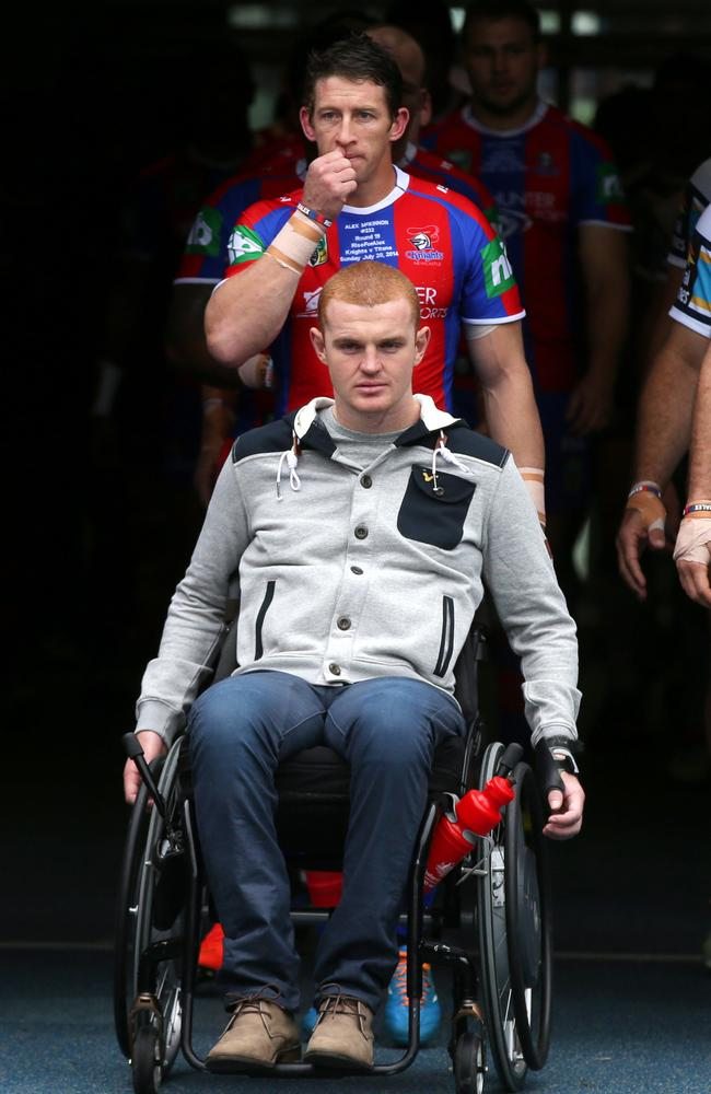 Kurt Gidley wheels out Alex McKinnon. Pic: Gregg Porteous