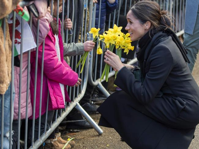 Meghan Markle also received flowers from a young wellwisher. Picture: AFP