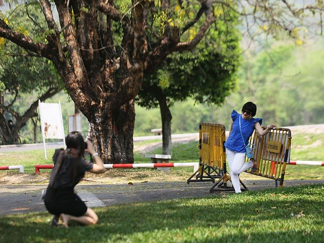 Chinese tourists take pictures at Chiang Mai University.