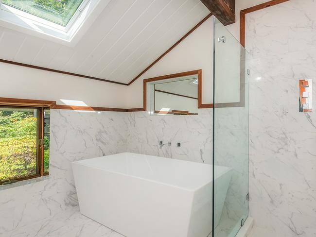 The new bathrooms are no doubt a far cry from when Angelina lived there. Picture: Ellis Sotheby's
