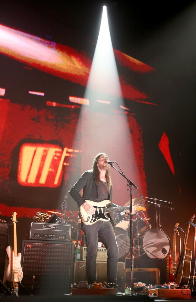 Singer and guitarist Jonathan Wilson – 'the resident hippie' of Roger Waters' band – sings Pink Floyd's  <i>Breathe </i>during Waters' Brisbane Entertainment Centre concert. Picture: AAP Image/Steve Pohlner