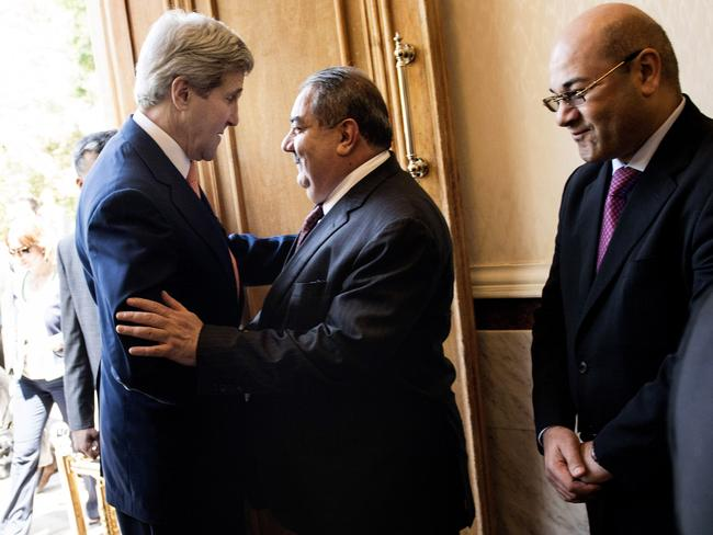 Meetings ... US Secretary of State John Kerry, left, is greeted by Iraqi Foreign Minister Hoshyar Zebari, centre, ahead of a meeting at the Prime Minister's office in Baghdad.