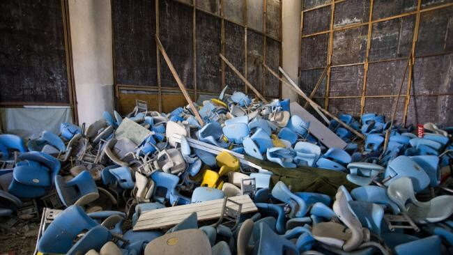 Broken seats had been thrown in a pile at the dilapidated Maracana Stadium after the Rio Olympics. Picture: Guito Moreto/Agência O Globo