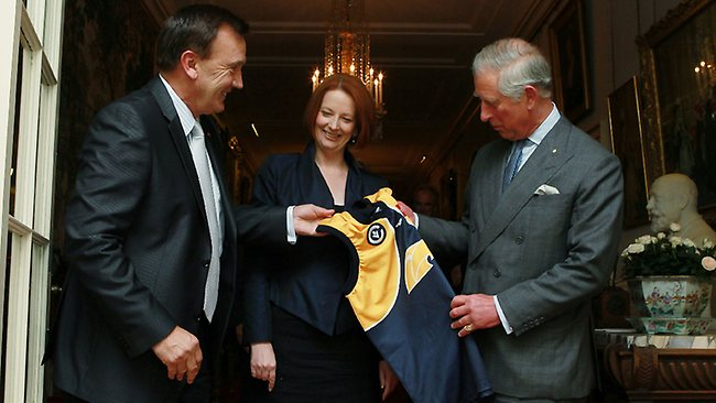 Tim Mathieson and Julia Gillard present Prince Charles with a Mansfield footy jersey / Picture: Britta Campion