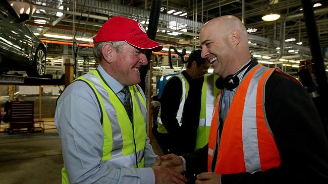 Federal Industries Minister Ian Macfarlane and Mike Devereux, Holden Chairman and Managing Director at the Holden factory in Elizabeth, South Australia.