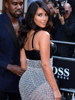 What a dress ... Kim Kardashian and Kanye West attend the GQ Men of the Year awards. Picture: Getty Images