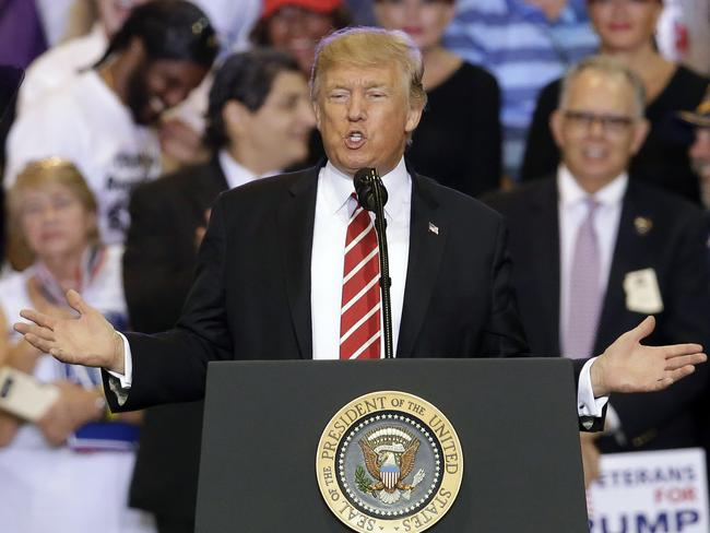 President Donald Trump speaks at a rally at the Phoenix Convention Center on Tuesday night. Picture: AP Photo/Rick Scuteri