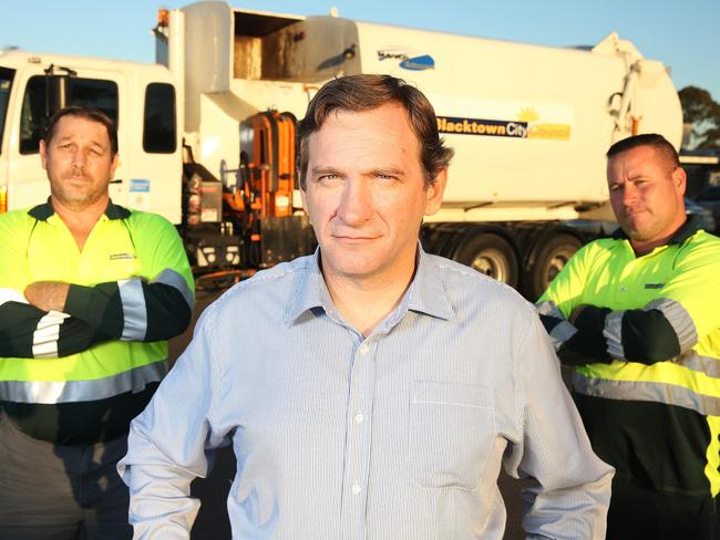 Blacktown Mayor Stephen Bali with Barry Reidy, Damian Amburlah-Ramat, garbage truck drivers from Blacktown City Council. Picture Craig Greenhill