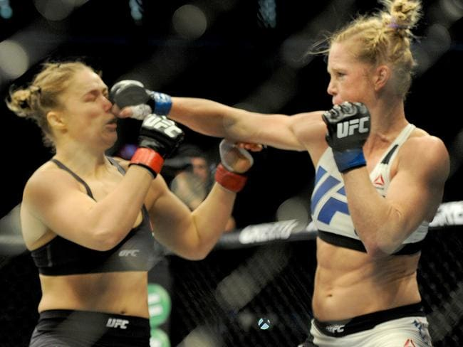 Holly Holm strikes defending champion Ronda Rousey in the face. Picture: AAP/Joe Castro.