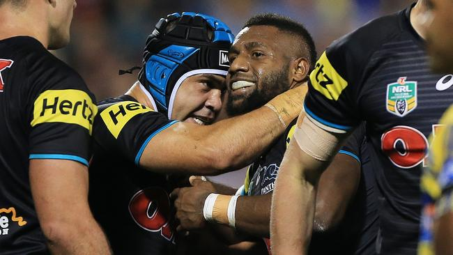 James Segeyaro celebrates a try for the Panthers with Jamie Soward.