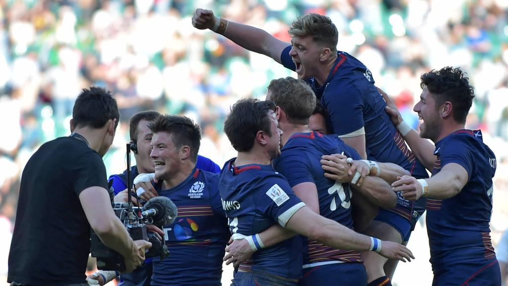 Scotland celebrate after defeating England to win the London Sevens.