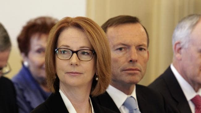 PM Julia Gillard faces an election wipeout. She appears here with Opposition leader Tony Abbott. Photo: Ray Strange