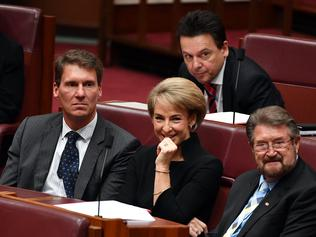 (L-R) Australian Conservatives Senator Cory Bernardi, Minister for Employment Michaelia Cash, Nick Xenophon Team leader Senator Nick Xenophon and Justice Party Senator Derryn Hinch during a division for an amendment to part 18C of the Racial Discrimination Act in the Senate chamber at Parliament House in Canberra, Thursday, March 23, 2017. (AAP Image/Mick Tsikas) NO ARCHIVING