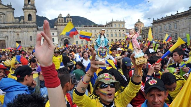 Colombian fans celebrate during the fan fest in Bogota during the game against Uruguay.