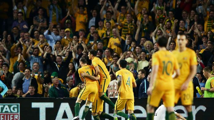 Massimo Luongo of the Socceroos celebrates with team mates after scoring a goal during the 2018 FIFA World Cup Qualification match between the Australian Socceroos and Jordan at Allianz Stadium.