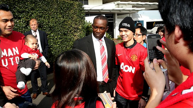 Manchester United's Dwight Yorke poses for photographs as he walks through Sydney Airport after the team arrived on a Private Charter aircraft at Sydney International Airport Picture: Porteous Gregg