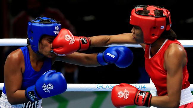 Kiribati's Taoriba Biniati, left, fights Mauiritius Isabelle Ratna in the women's light 57-60 kg boxing bout during the 2014 Commonwealth Games in Glasgow.