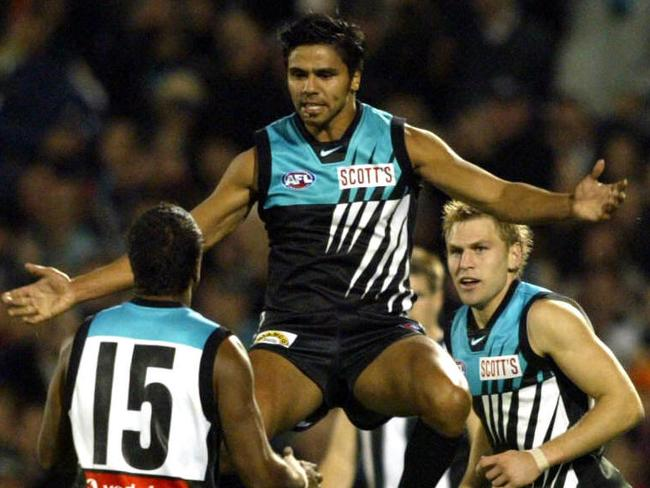 Che Cockatoo-Collins celebrates after kicking a goal against Collingwood at AAMI Stadium in 2003.
