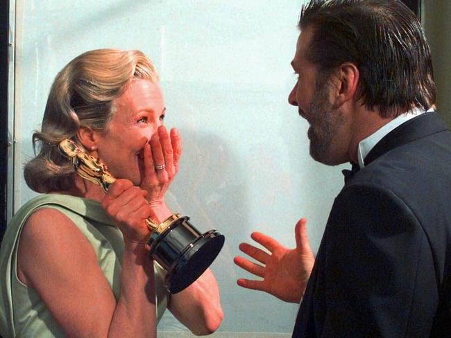 Kim Basinger and her then husband, Alec Baldwin, react backstage after she won the Oscar for Best Supporting Actress.