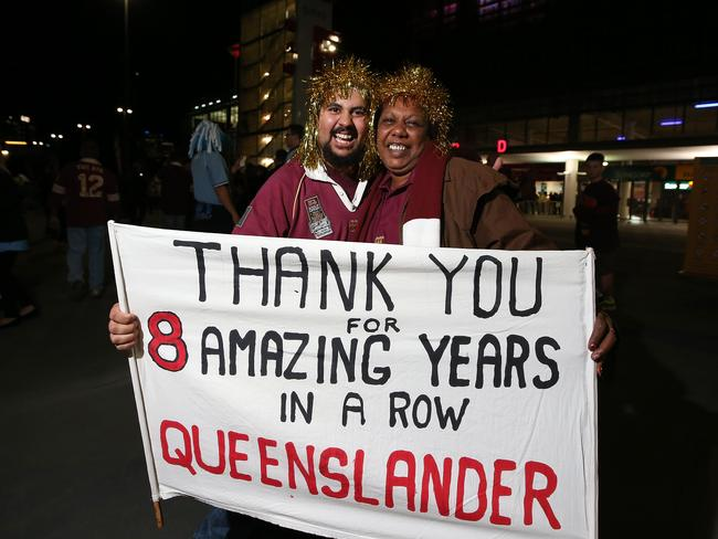 Queensland fans Chris Tyson and Annette Eggmolesse outside Suncorp Stadium ahead of State of Origin III.