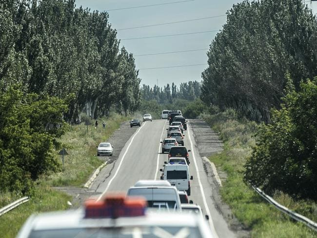 Setbacks and frustrations ... Forensic teams' convoys are pictured on their way to the crash site. Picture: Bulent Kilic