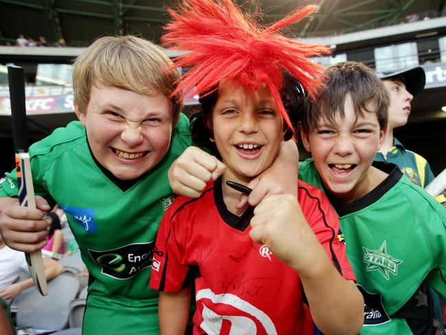 Young Melbourne Stars and Melbourne Renegades fans share the excitement of a KFC Big Bash League derby.