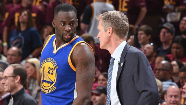 Golden State Warriors player Draymond Green (L) and head coach Steve Kerr (R).