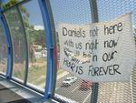 A sign erected on the the overpass bridge in March 2004 reads 'Daniel's not here with us right now but will be in our hearts forever'. Picture: Megan Slade