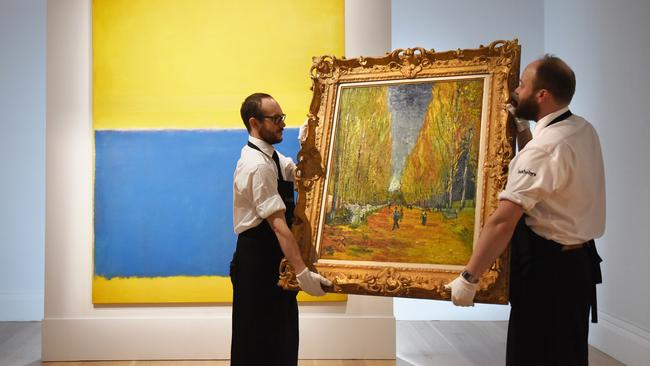 Sotheby's London staff prepare a Van Gogh for display near a Rothko. Picture: Getty Images